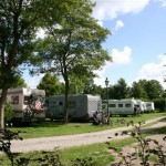 Campers beside path